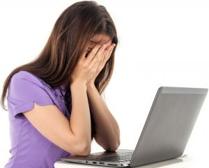 woman frustated with laptop